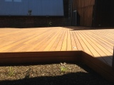Courtyard decking made from salvaged timbers.