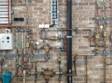 Rather curiously, I think this is one of the most beautiful parts of the building - the pipework and control system for the storm and rain water collection.